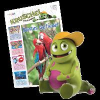 Kruschel sitzt vor der Zeitung